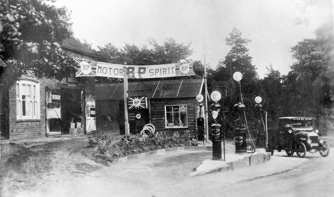 "Willy Henson bought the Wheelwright's on this site and established a petrol station. A good location because vehicles had difficulty reaching the top of what was then a very steep hill. The BP lorry is a Karrier made by Commer. It also delivered to Goodacre's petrol station in front of ""The…"