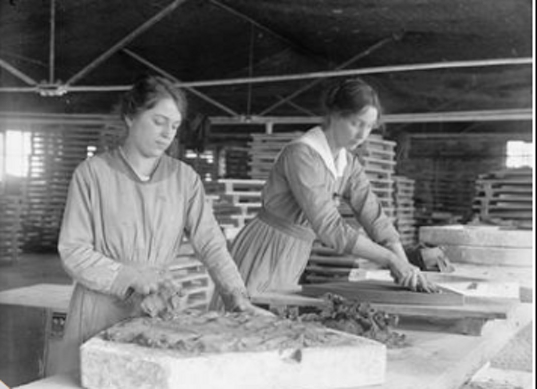 The Employment of Women in Britain, 1914-1918 Female workers mould and finish plates for vibrating pans used in the production of gun cotton at the Hathern Station Brick and Terracotta Company Ltd. in September 1918